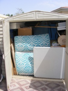This is my shed. Completly stacked to the brim with my exhibition/fair stuff. Except for the blue floor sofa, its all MY STUFF !!